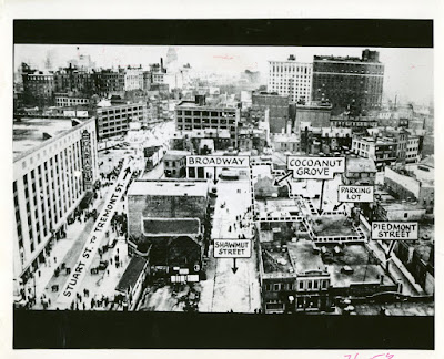 "Printed in 1943 ""The Cocoanut Grove Night Club Fire"" by Robert S. Moulton of NFPA.  Caption: ""The locale of the tragedy.  The Cocoanut Grove, located on the edge of Boston's hotel and theatre district, had been converted from old buildings.  The original area of the Grove near the center of this picture had formerly been a garage and a motion picture fil exchange.  The Broadway extension, a recent addition to the night club, incorporated three small tenement buildings.  These extend above the roof of the main one-story section seen in this picture.""   Courtesy of NFPA.  Copyright queries to NFPA."