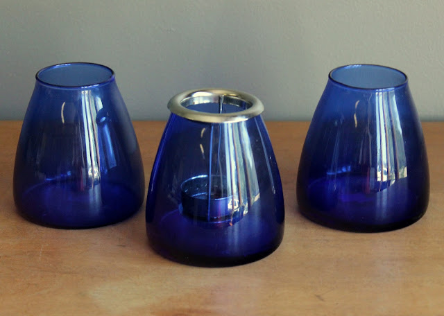 Cobalt blue votive holders with removable silver sleeve available for rent from www.momentarilyyours.com