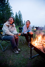 Photo: Group of people sitting around campfire while camping on Jackson Lake. Grand Teton NP, WY