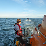 16 July 2014 - Trainee Joe Manning manning the tow(!) as Poole ALB tows a 7m day boat with engine failure back to Poole  Photo: RNLI Poole/Alex Evans