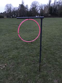 Photo shows Jim's training aid, a hoop inside an upside-down L-shaped frame