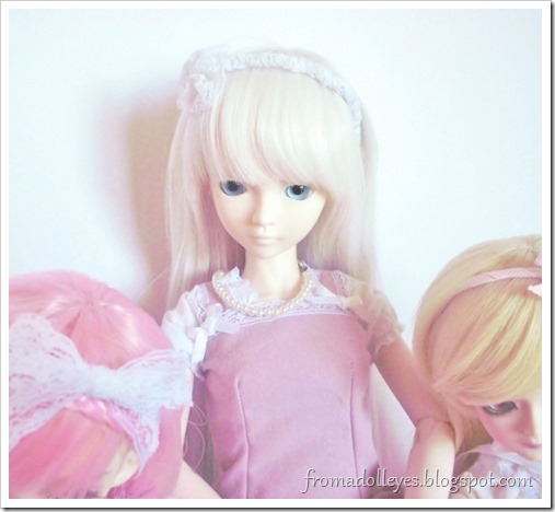 Close up of our white haired narrator bjd as she has her final say.  She really wants to keep the pink box too.