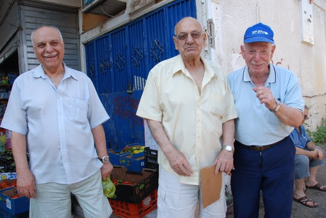 three men in tiberias market