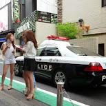 Tokyo Police driving by at Campus Summit 2013 in Shibuya, Tokyo, Japan