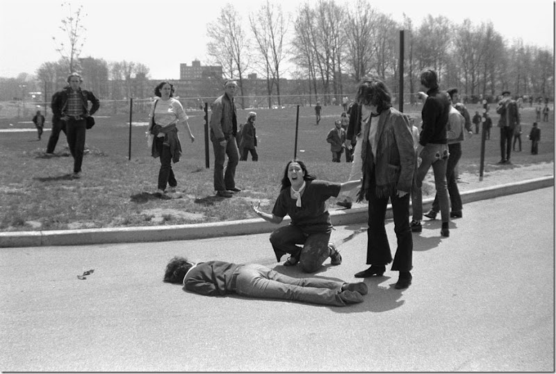 Mary Ann Vecchio screams as she kneels over the body of fellow student Jeffrey Miller during an anti-war demonstration at Kent State University, Ohio, May 4, 1970. Four students were killed when Ohio National Guard troops fired at some 600 anti-war demonstrators. A cropped version of this image won the Pulitzer Prize.