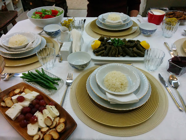 Turkish meal with cheese, bread, dolma and rice