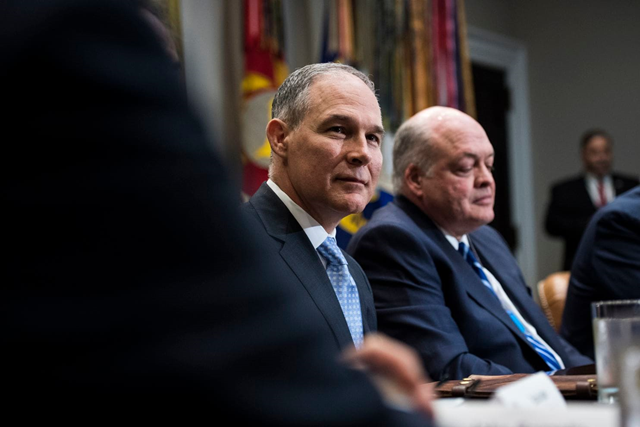 Scott Pruitt, then the head of the Environmental Protection Agency, listens as President Trump speaks during a round table with auto executives in May 2018. Pruitt resigned from the agency in July 2018. Photo: Jabin Botsford / The Washington Post