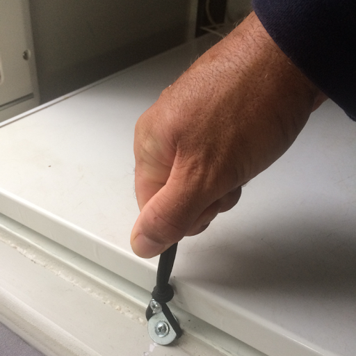 Our new fridge catch is simply strong elastic, screws and a washer. It's easy to use and does the job'