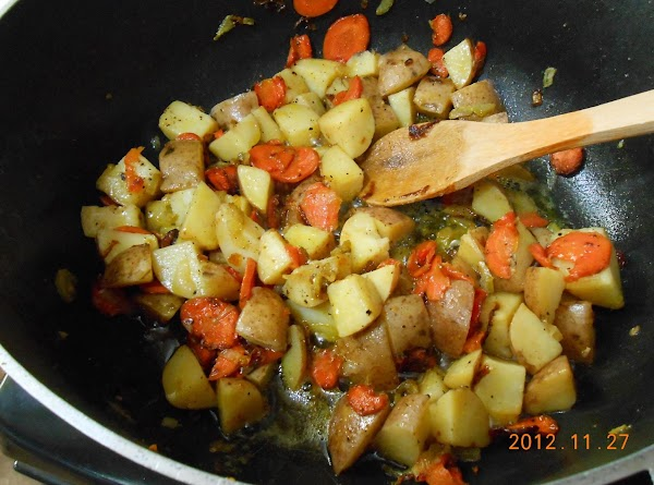 In another large pot add butter, sliced carrots, sliced celery, sliced onion, and minced...