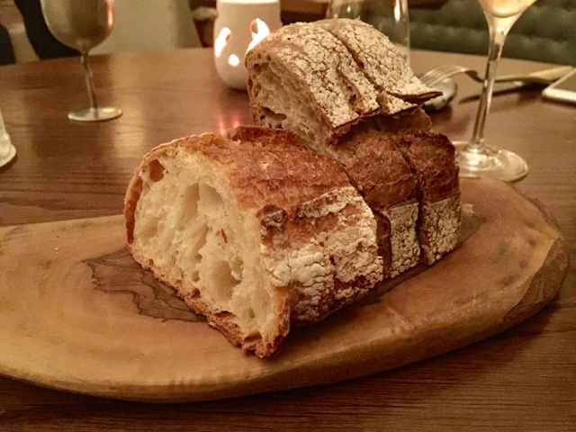 White and brown crusty bread with olive oil and lava salt in Texture restaurant in London