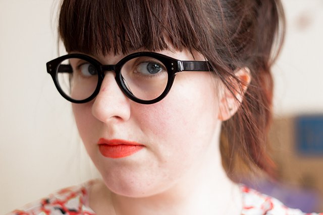 photo of face, wearing glasses and lipstick