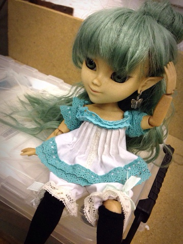 A green haired 3D printed Makie doll wearing hand made victorian era inspired underwear.