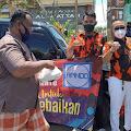 Pemuda Pancasila  Kota Mojokerto Gelar Aksi Kemanusiaan Berbagi Nasi Bungkus dan Masker