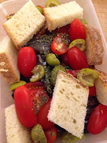 Aubergine, tomatoes, olives and bread