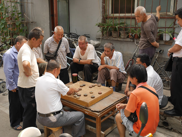 Man making a move in a xiangqi game in Beijing