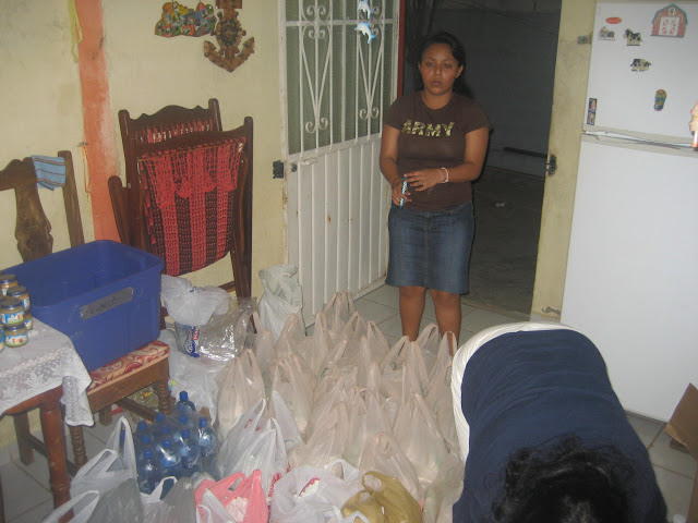 "Each bag of food and supplies or ""despensa"" was handed out to a needy family."