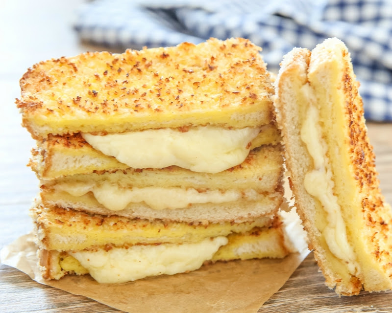 close-up of panko crusted grilled cheese sandwiches