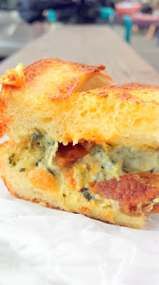 Bazi Brasserie offered a grilled cheese using Pullman loaf, spinach dip, manchego cheese, bleu cheese, cream cheese, bacon and Delirium Tremens red pepper coulis