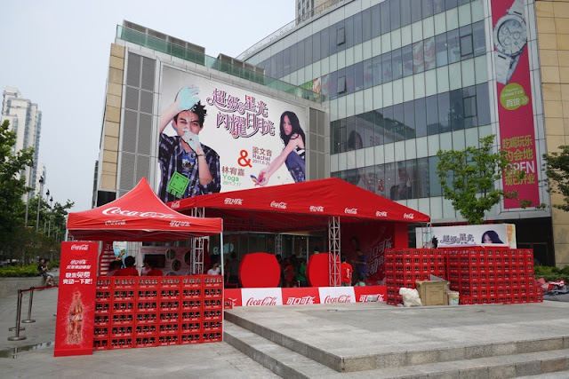 However I have yet to see any more Coca-Cola police tents. But a few weeks ago in Shanghai next to a large shopping center I did see some Coca-Cola tents ... & Coca-Cola Tents in Shanghai: More of a
