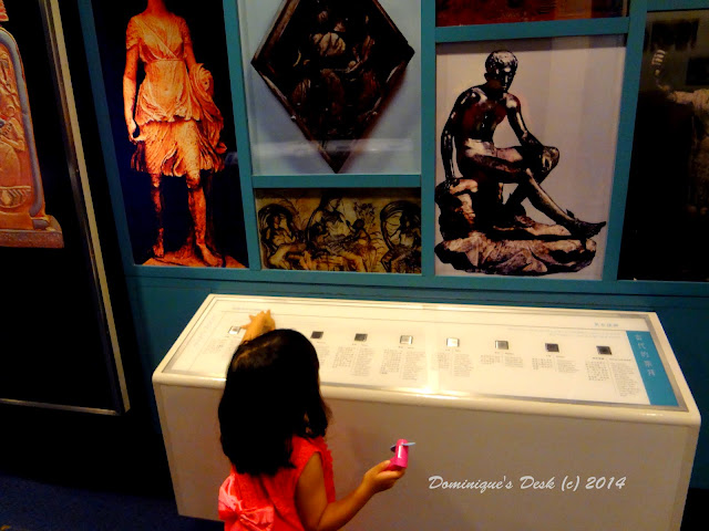 Tiger girl looking at the exhibit on famous people in history