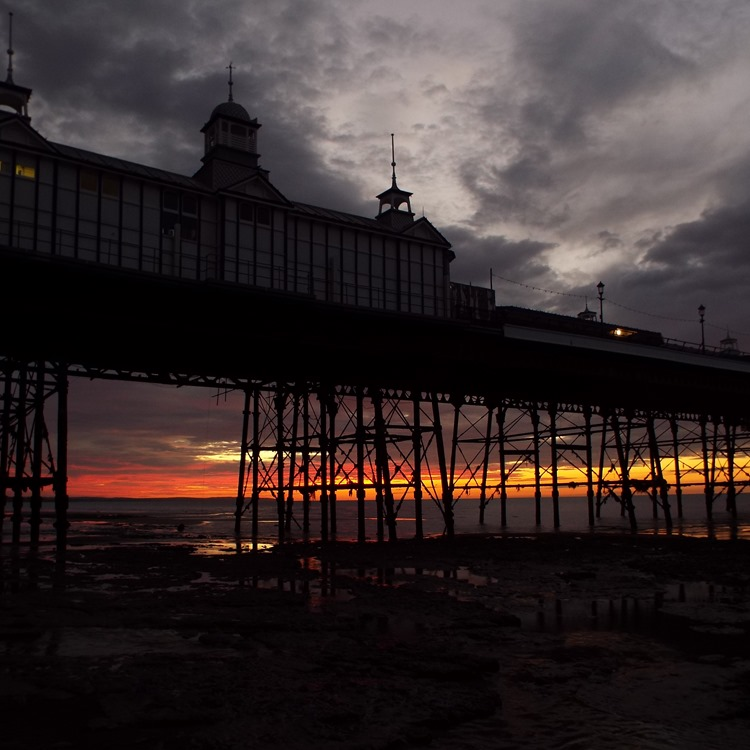 Sunrise behind the pier