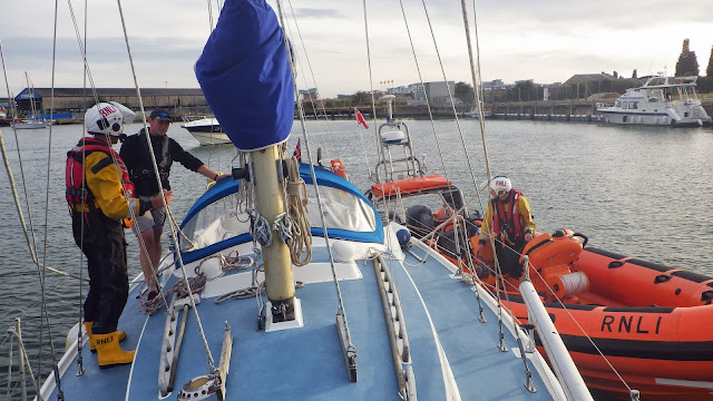 The ILB and crew assist a yacht and skipper to its berth after suffeting mechanical problems. 1 September 2013 Photo: RNLI/Poole