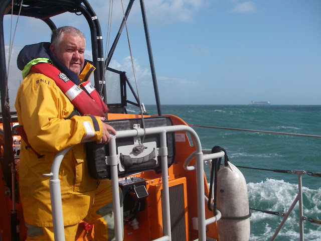 11 September 2011 - Coxswain Jonathan Clark at the helm of the ALB, with Brittany Ferries' Barfleur on the horizon