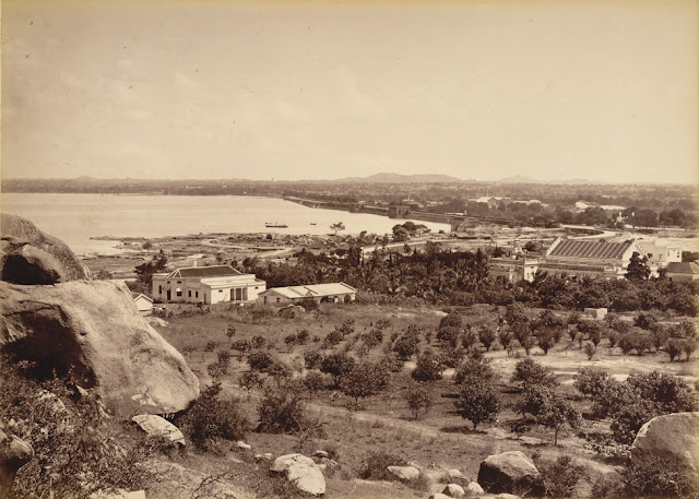 View of the Husain Sagar lake to the north of Hyderabad, photographed by Deen Dayal in the 1880s. This is from the Curzon Collection: 'Views of HH the Nizam's Dominions, Hyderabad, Deccan, 1892'. Husain Sagar is an artificial lake which divides the twin cities of Secunderabad and Hyderabad in Andhra Pradesh. The lake was created in the 16th century by Ibrahim Quli Qutb Shah (r.1550-80) and named after Husain Shah Wali, who had helped the sultan recover from illness. It was created by enlarging an existing small stone dam across the valley. The lake supplied the townspeople with water as well as irrigating the surrounding land.