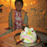 Birthday cake for Kuku and me (his nephew is pictured), at Kuku's Coffee Shop in the fort at Jaisalmer.