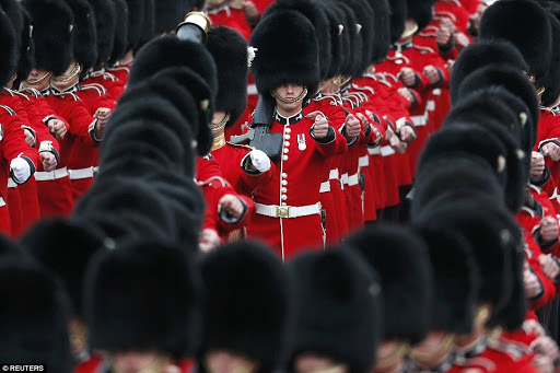 Guardsmen march past Buckingham Palace before the Trooping the Colour ceremony at Horse Guards Parade in central London.jpg