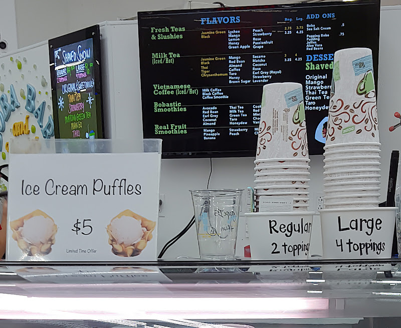photo of the puffle cone sign on a counter with ice cream cups