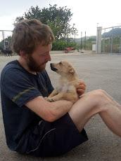 Simon cuddling the dogs