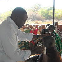 Dr. Kirumbi removing a dressing