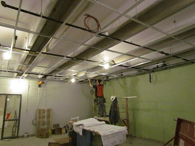 Ceiling grid in classroom gets installed