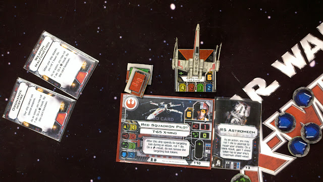 A model and matching ship card from X-Wing