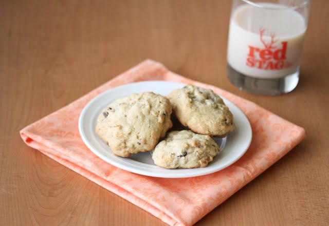 a plate of cookies with a glass of milk