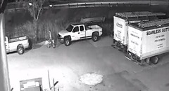 SUSPECT RUNNING THE TOOLS TO HIS TRUCK