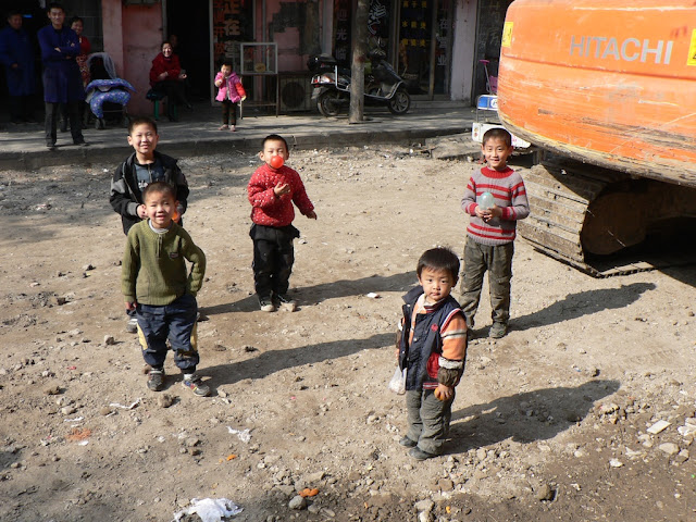 five boys standing in the middle of a road construction site in Shangqiu, China