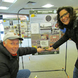 Library patrons stop to read the exhibit panels on display at the West Bloomfield Library. Robert and Deanna Goralczyk enjoy pointing to their son who attended Doherty.