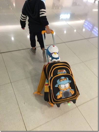 That newly bought Doraemon coin bank at HKIA