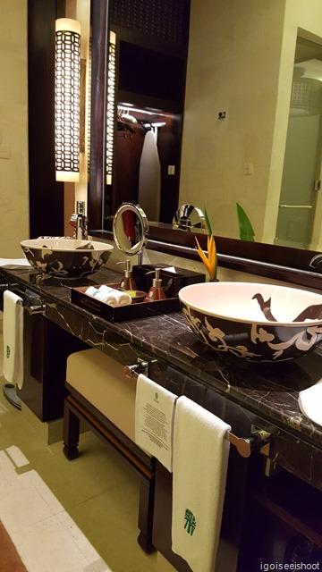 Bath area with basins and toiletries at Beach Villa at Banyan Tree Lang Co