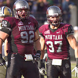 Alex Bienemann (#92) and Jordan Tripp let out some grizzly roars after Bienemann's tackle at the line during the first half of Saturday's loss.  Washington-Grizzly Stadium in Missoula, Mont., November 17th, 2012.