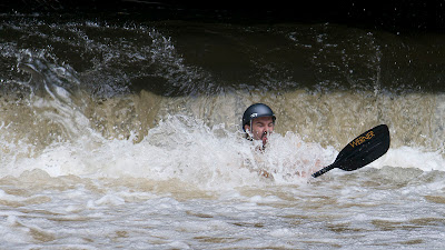 Chris going down in the whitewater.