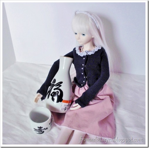 A ball jointed doll with some sake.