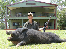 Lucas Tilgaard, Denmark with a big trophy wild boar taken at Carmor Plains. This boar was literally passing by the front of the lodge when Lucas shot him! No shortage of boars out here!