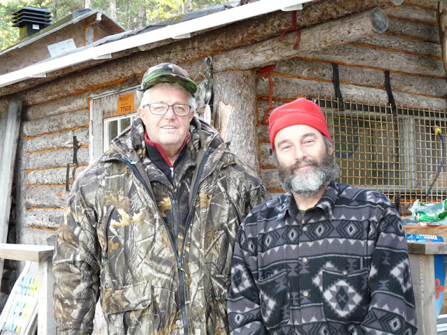Claude Moisan and Raynald Pilon in front of the hunt camp.