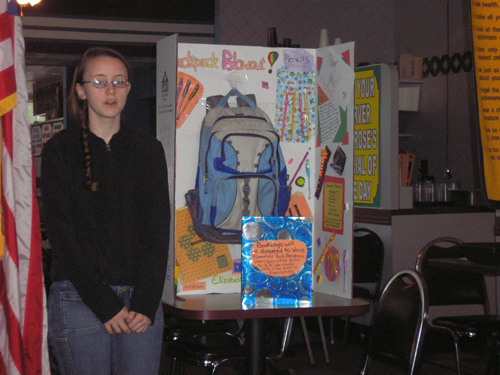 """May 2006, Elizabeth Magee speaks to the club about """"Backpacks Blowout."""" This program is sponsored by West Bloomfield Youth Assistance. Our club made a donation to this worthy cause."""