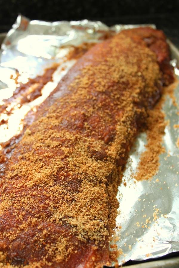 Dry rub rubbed onto rack of ribs.