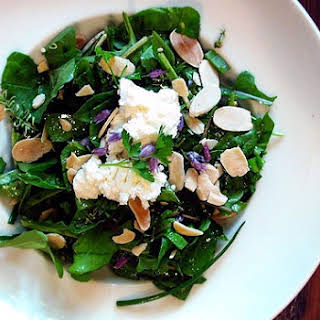 Spring Salad with Baby Greens, Herbs, Meyer Lemon, Almonds and Goat Cheese.