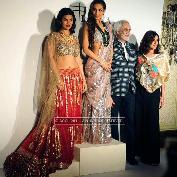 Nimrat Kaur , Malaika Arora Khan, Sunil Sethi , Rina Dhaka pose for the camera on Day 2 of India Couture Week, 2014, held at Taj Palace hotel, New Delhi.